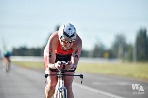 Melanie McQuaid riding Ironman Miami 70.3 bike course